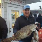 Jeff with Grouper caught on the Gulf Queen